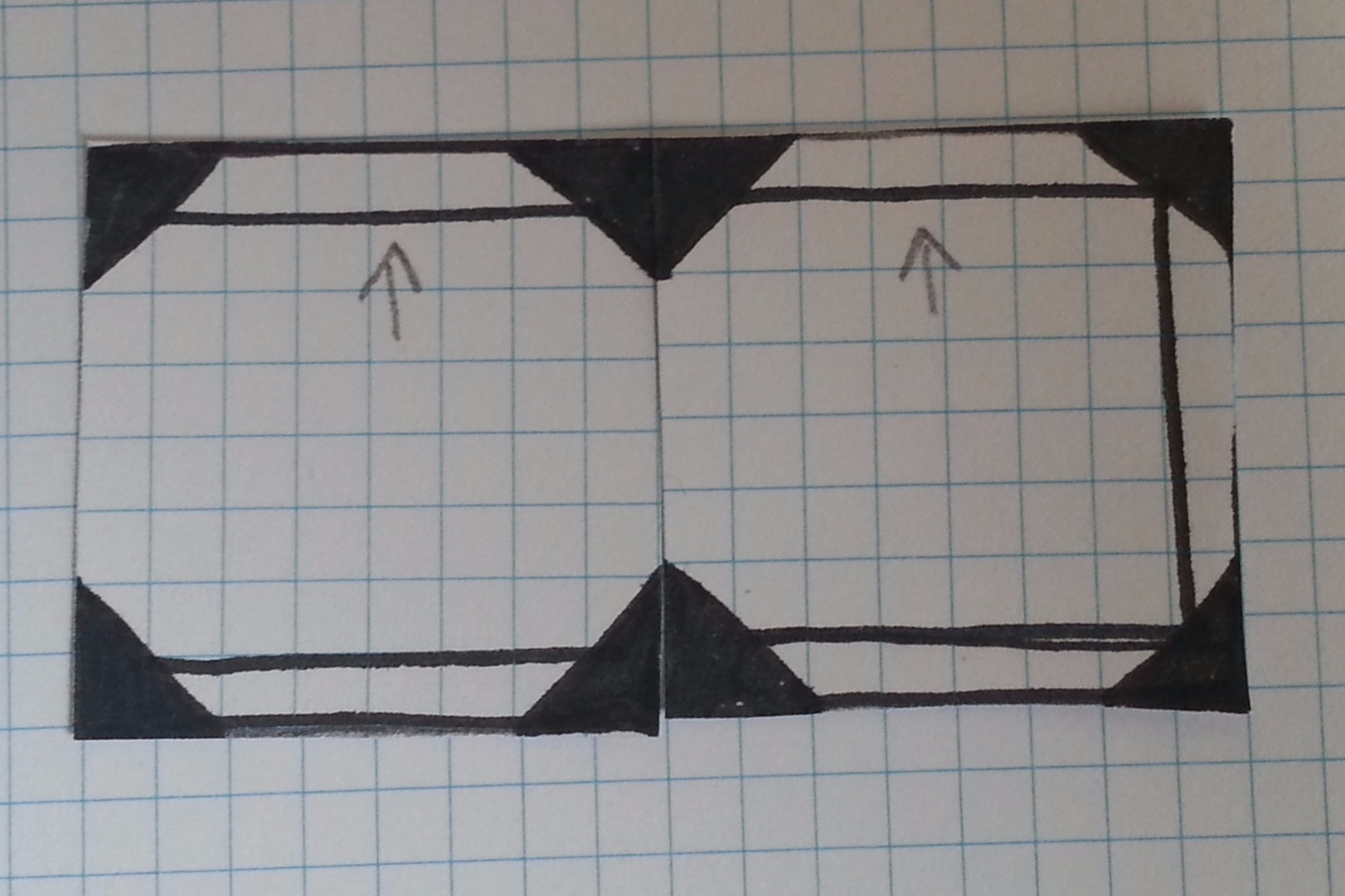 "Two tiles can be arranged to create a very simple corridor. The arrows on the paper simply indicate which direction is ""up"" so tiles can be differentiated."